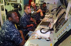 JAVA SEA (May 8, 2012) Marine Technician Leading Seaman Grant Darling explains the functions of the machinery control room aboard Royal Australian Navy frigate HMAS Ballarat (FF 155) to Sailors assigned to U.S. 7th Fleet flagship USS Blue Ridge (LCC 19). (U.S. Navy photo by Mass Communication Specialist 3rd Class James Norman)