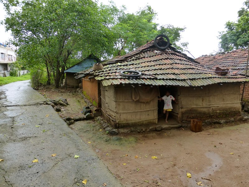 Lonad Caves - mud huts at the base