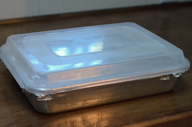 The plastic cover is placed on top of the pan.
