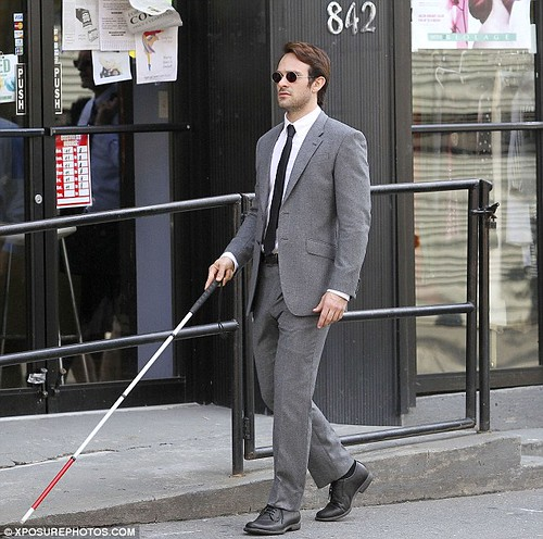 Matt Murdock walking down street with cane