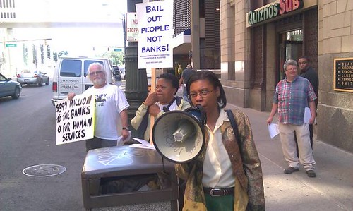 Atty. Vanessa Fluker speaking outside U.S. Bank in downtown Detroit's financial district. The bank is connected with servicing municipal debt which is strangling the city. (Photo: Abayomi Azikiwe) by Pan-African News Wire File Photos