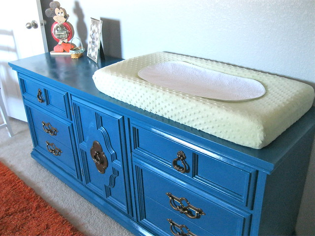 teal dresser with changing pad
