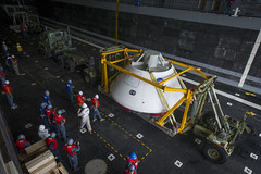 Orion capsule is loaded aboard USS Arlington.