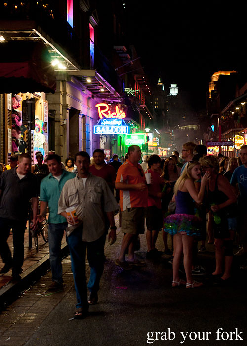 bourbon street at night partygoers in new orleans louisiana