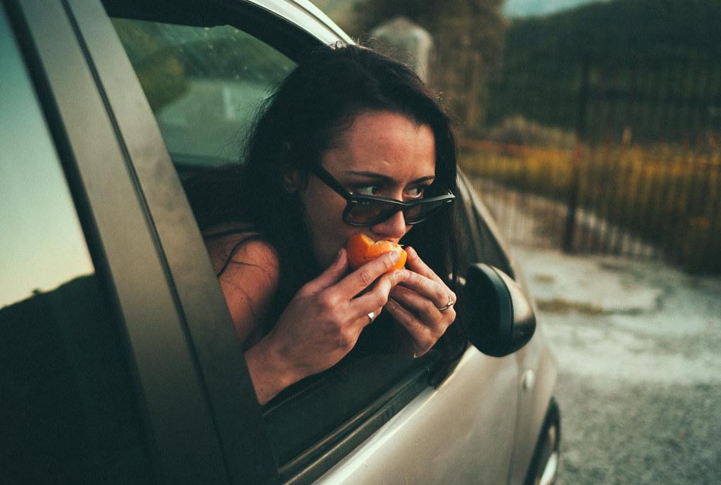 eating orange picked from roadside