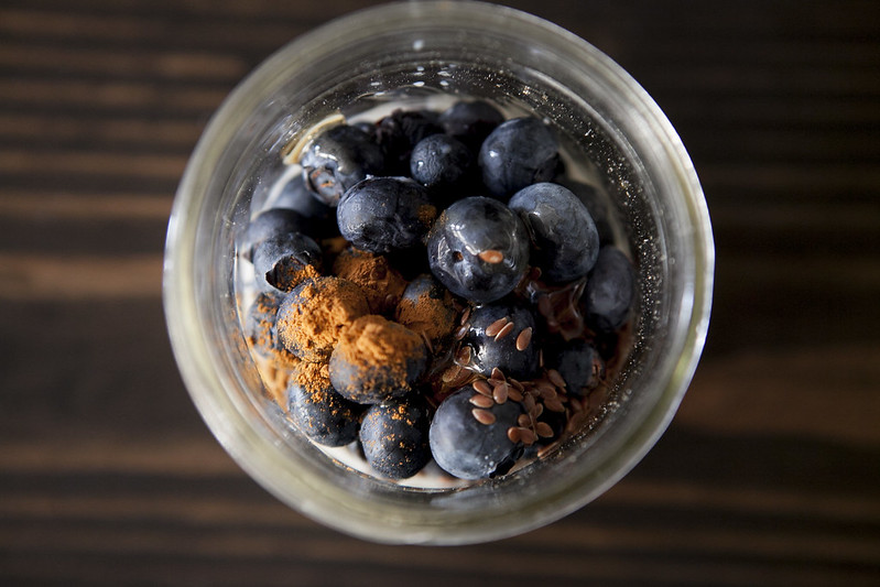Overnight Blueberry Maple Oatmeal is a quick breakfast that's waiting for you in the morning! Healthy ingredients include oats, blueberries, milk, syrup, flax seeds and cinnamon!