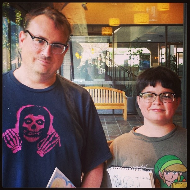 Logan and his art teacher. Hmmmm, I wonder where his love for geek glasses comes from?  ;-)