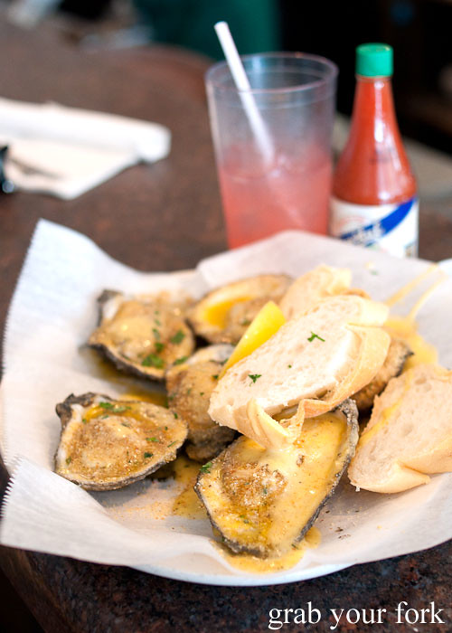 char-grilled oysters at felix's restaurant and oyster bar new orleans louisiana