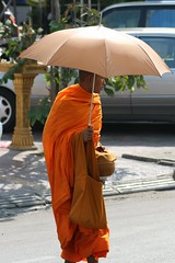 monk with umbrella close
