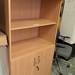 Oak tall b/case c/w doors