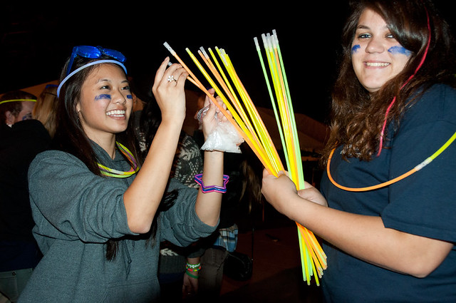 two students with glow sticks