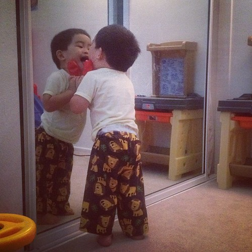 At 20 months old (today) he still plays with the baby in the mirror.