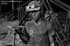 Title: Worker Description: Work place safety is most often neglected in factories among developing countries like Bangledesh. Asgar Mia, 26 years of age, works in an industrial factory, continually facing hazardous conditions where protection and insurance is limited or non existent. Author: Mohammad Rabikul Hasan, Bangladesh This photo was awarded the