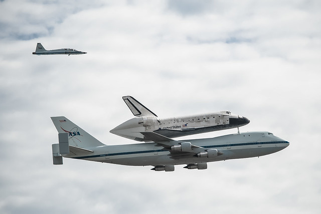 Space Shuttle Discovery Flies Over DC