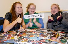 Three students giving thumbs up in the Deer Isle-Stonington High School Writing Center.