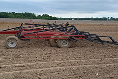 crop(0.0), agriculture(1.0), farm(1.0), sowing(1.0), field(1.0), soil(1.0), vehicle(1.0), plough(1.0), agricultural machinery(1.0), land vehicle(1.0), harvester(1.0),
