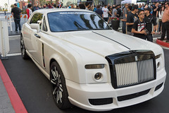 rolls-royce wraith(0.0), sedan(0.0), sports car(0.0), automobile(1.0), automotive exterior(1.0), rolls-royce(1.0), wheel(1.0), vehicle(1.0), automotive design(1.0), rolls-royce phantom coupã©(1.0), rolls-royce phantom(1.0), auto show(1.0), rolls-royce phantom drophead coupã©(1.0), bumper(1.0), land vehicle(1.0), luxury vehicle(1.0), motor vehicle(1.0),