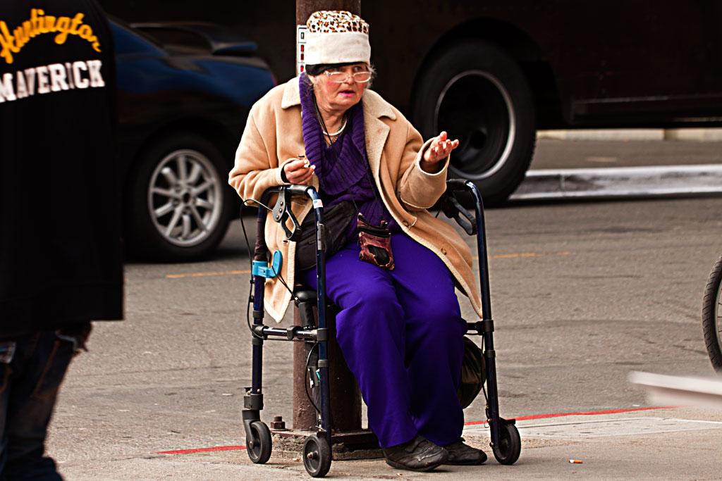 Old-woman-in-leopard-hat,-begging--Berkeley