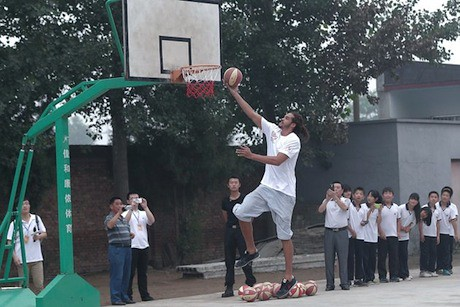 June 30th, 2012 - Joakim Noah puts up a shot at primary school for children of migrant workers at Changping District in Beijing