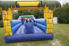 playhouse(0.0), outdoor play equipment(1.0), play(1.0), recreation(1.0), leisure(1.0), games(1.0), playground slide(1.0), inflatable(1.0), playground(1.0),