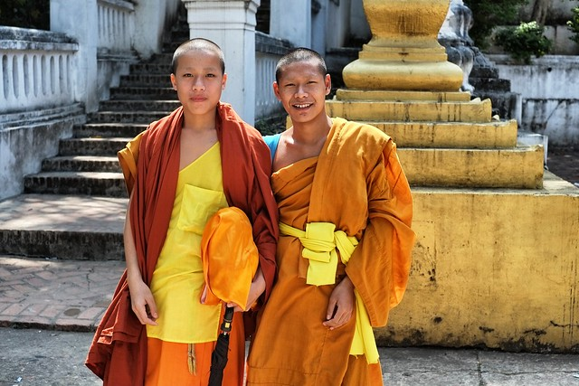 Two monks at Wat Siphoutthabat Thippharam.  Luang Prabang, Laos.