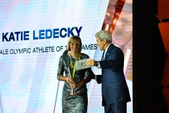 U.S. Secretary of State John Kerry presents Katie Ledecky with the 'Female Athlete of the Olympic Games' award at the U.S. Olympic Committee Team USA Award Show, at Georgetown University, in Washington, D.C. on September 28, 2016. [State Department Photo/ Public Domain]