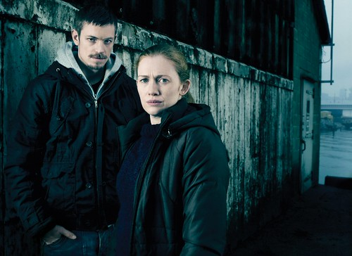 Linden and Holder on the Killing, wearing dark jackets and sweaters that they never take off