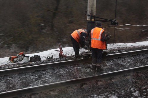 Russian railway workers repairing the tracks