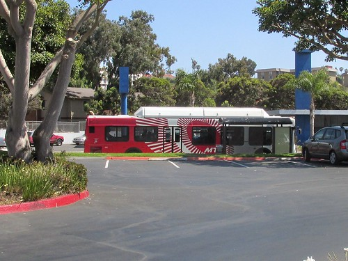 San Diego California MTS /  Metropolitan Transit system bus making a stop on Nimitz Boulevard in Point Loma California.  June 2013. by Eddie from Chicago