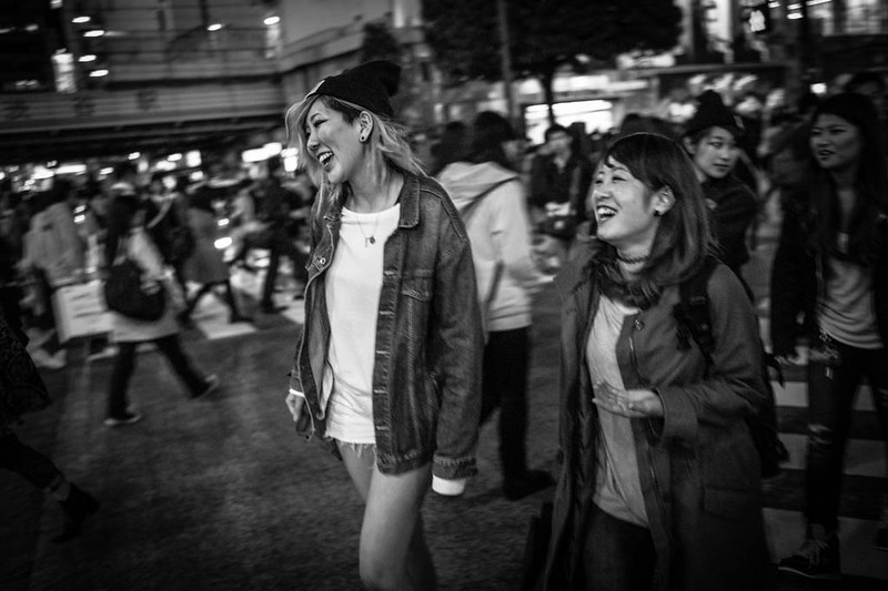 Sharing a light moment while crossing Shibuya Crossing.