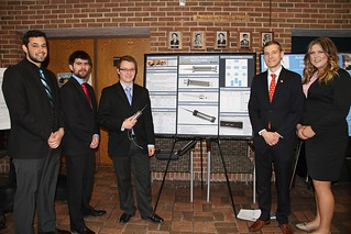 Low Voltage Piezoelectric Bone Sculptor Team posing with poster