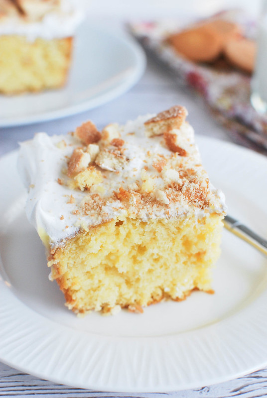 Banana Pudding Poke Cake - super delicious cake that starts with a boxed mix and is filled with banana pudding! Tastes like an old-fashioned layered banana pudding!
