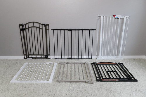 Six pet gates lined up in living room