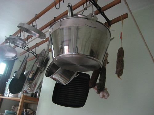 Saucisson and garlic, hanging up with the pans