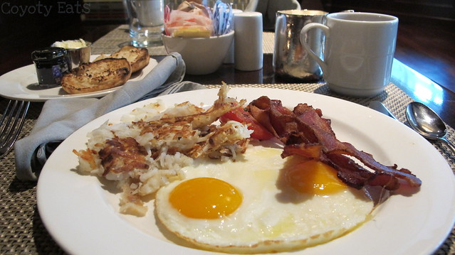 Sunny-side eggs, bacon, hash browns, english muffin, coffee