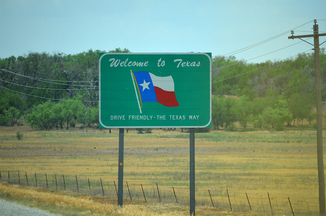 The sign to Texas is a welcome sight after several miles of driving