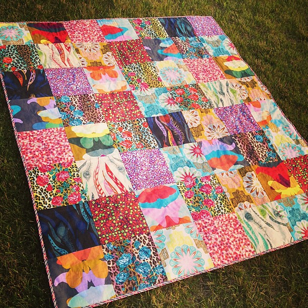 My first hand-tied quilt! This AMH awesomeness will live in our car and be our picnic/anywhere quilt. #amhismyhomegirl #quilt