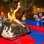 13-019 -- Allyson Auth '17 rides the mechanical bull at the Titan Carnival.