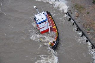 The uninspected towing vessel Todd Michael is grounded on Lake Pontchartrain, April 15, 2014. The Coast Guard rescued three crewmembers from the vessel after receiving the report from the UTV Todd Michael. (U.S. Coast Guard photo courtesy of Coast Guard Air Station New Orleans)