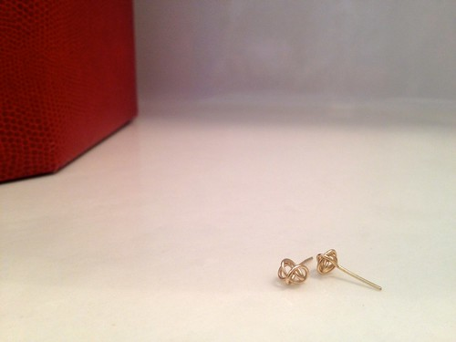 garnish gold knot earrings.