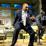 Harmond Wilks (Hassan El-Amin, l.) and Roosevelt Hicks (James A. Williams) celebrate with a riotous dance when the city of Pittsburgh declares their neighborhood blighted in the Huntington Theatre Company's production of August Wilson's <i>Radio Golf</i> at the Boston University Theatre. Part of the 2006-2007 season. Photo: Eric Antoniou.