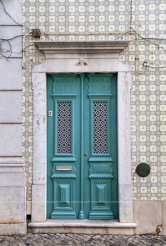 Tavira cyan door by Alida's Photos
