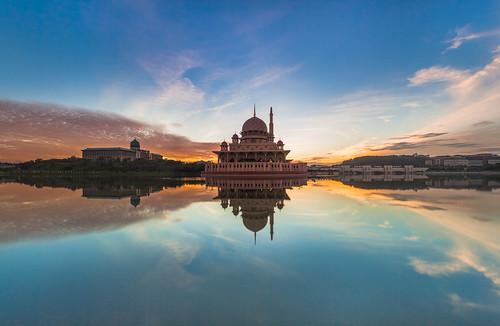 travel blue light cloud sun lake reflection green water yellow architecture sunrise canon landscape mirror mosque malaysia slowshutter 5d putrajaya masjid twop 1740f4 flickraward 5dmark2