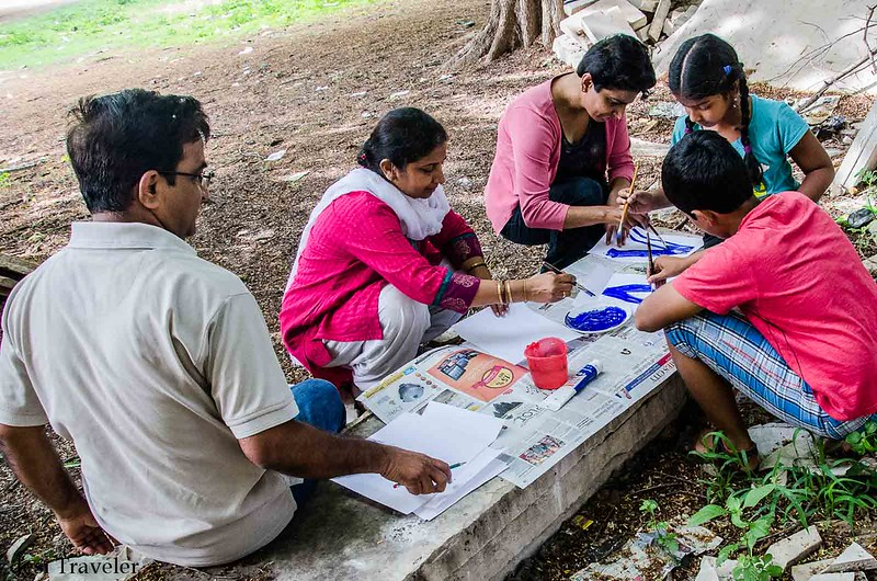 kids painting signs to save old baobab tree