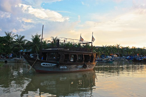 reflections of a boat on the river in Hoi An