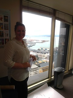 Helen Player pointing out sights in Wellington harbour, post talk.