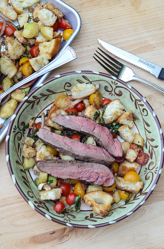 A serving of Panzanella Salad With Grilled Bison Flank Steak.