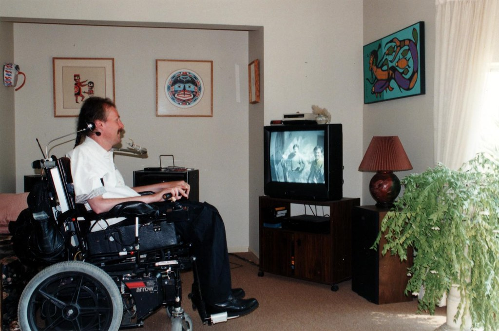 Larry Boden demonstrates the Gateway Project by controlling the television from his wheelchair.