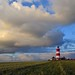 Early morning clouds over the lighthouse by Andrew Boxall