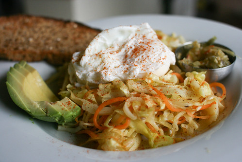 Poached egg with sauteed cabbage, carrots and paprika